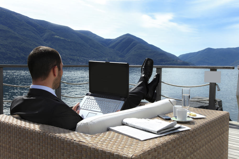 man-working-laptop-lake